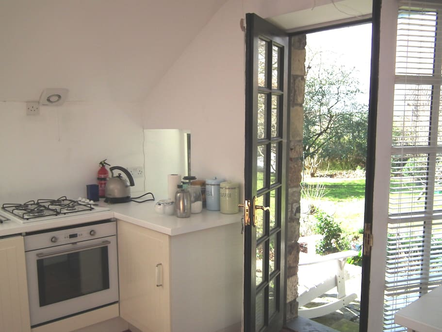 Part of the fitted kitchen with French doors to the patio and garden.