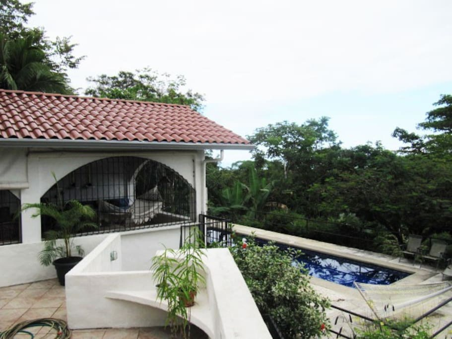 Main level patio with view to pool.