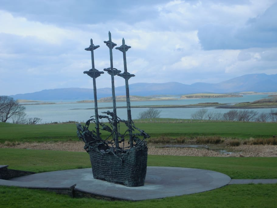 The Famine ship at Croagh Patrick with Clew Bay in background.