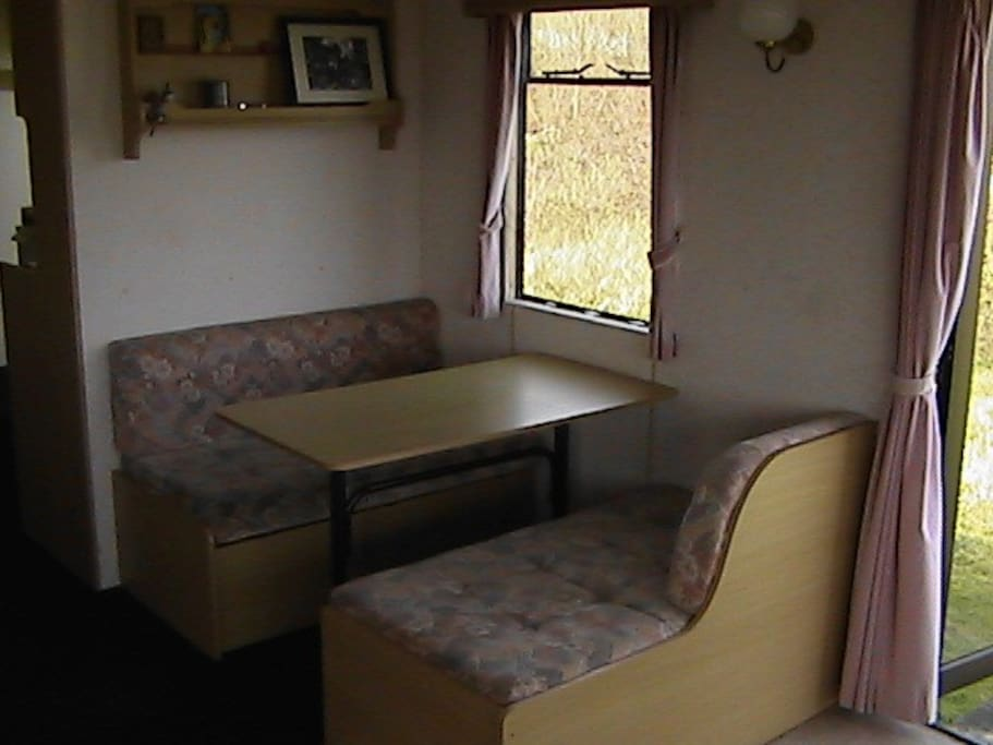 table/seating in lounge converts to 2nd double bed