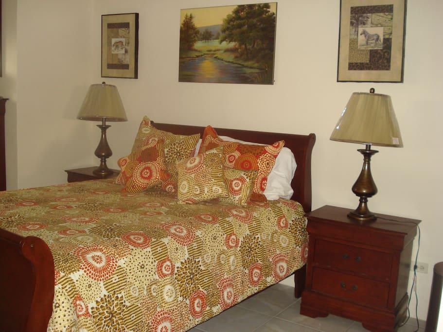 Queen sized bed in studio 2.