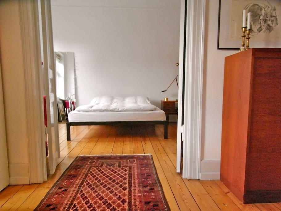 Master bedroom seen from dining room