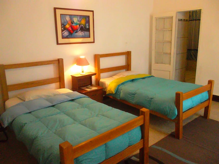 Room 1: Practical room with  two single beds with its own bathroom.