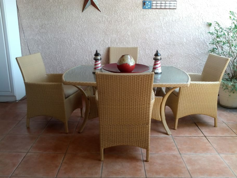 Large private patio with dining area and living area for relaxing with family and friends.