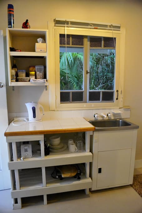 Kitchenette includes tea, coffee, breakfast basics, toaster, kettle, sandwich press, microwave, bar fridge