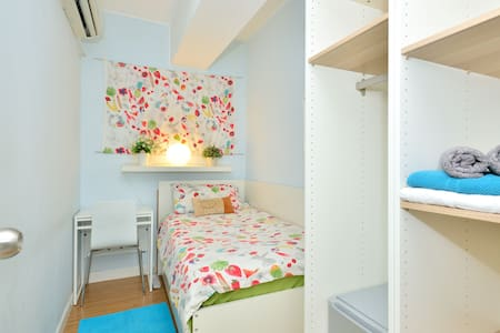 a single room with single bed  202