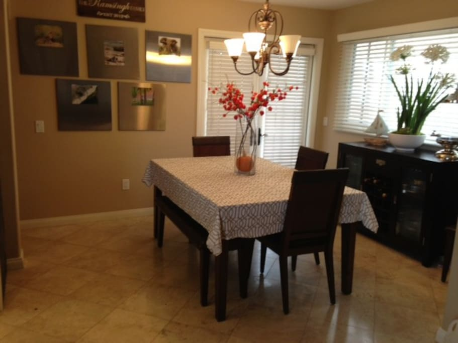 Dining room. Through doors is downstairs patio with gas grill.