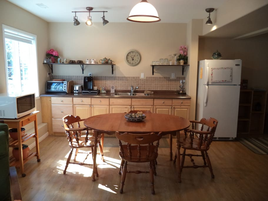 Fully equipped kitchenette and dining area.