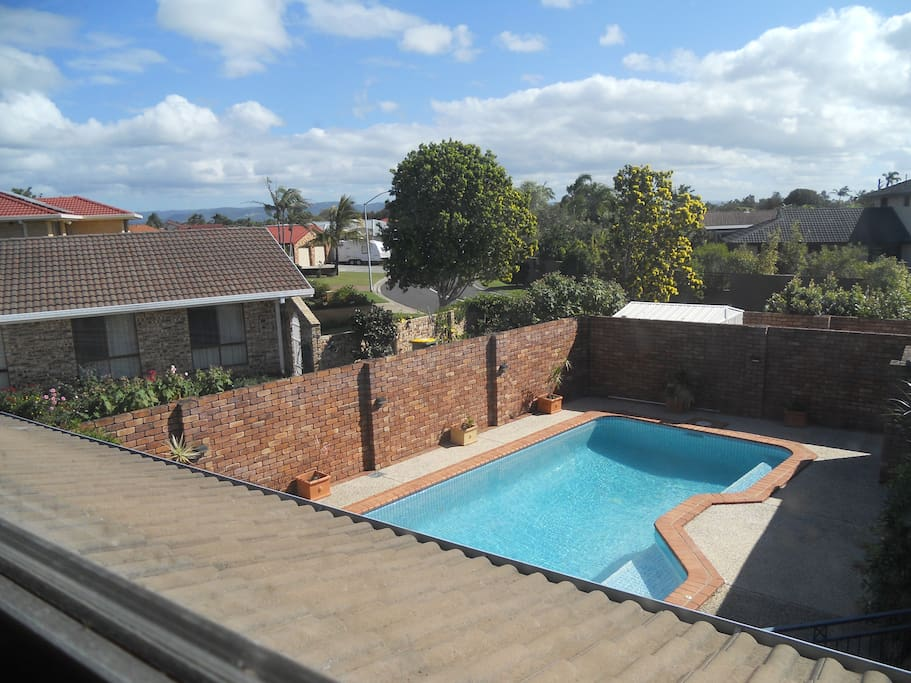 View from bedroom window overlooking the pool
