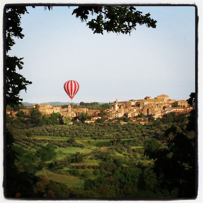 A view from our house: hot air balloon over Montisi.