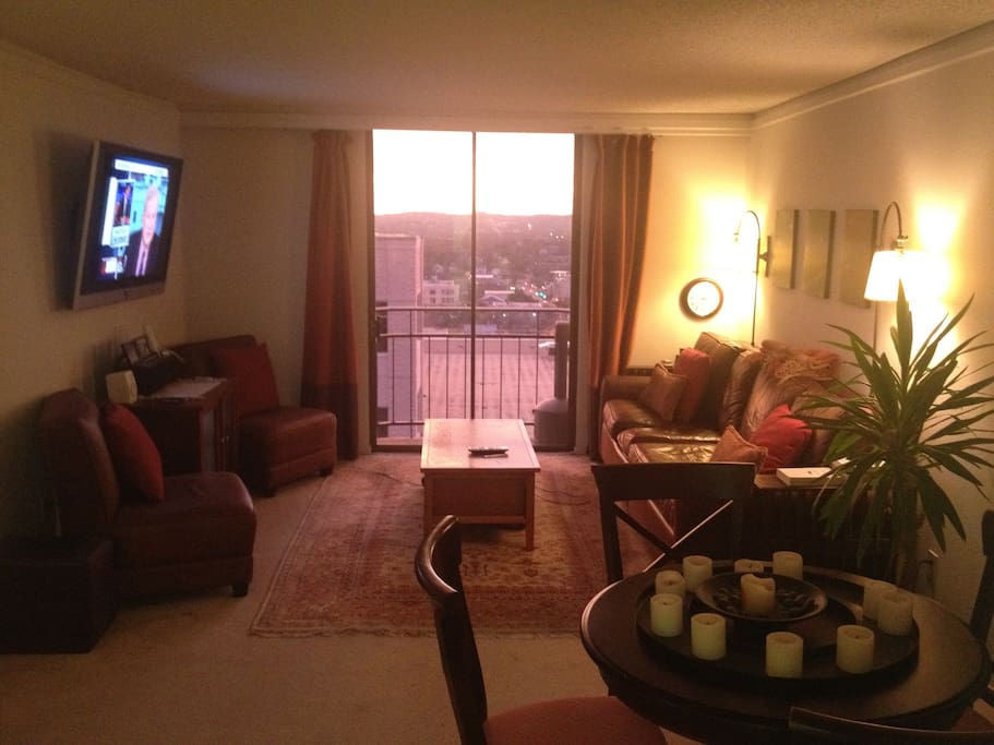 """Living room. Sofa is 7 feet in length and television is wall mounted and 50"""""""