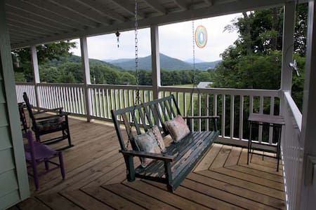 Situated at 4,100 feet, our 2 bedroom home feels like a well-traveled grandma's mountain retreat. Great views from large covered porch and from the spacious kitchen and living area. Extremely quiet but close to town.