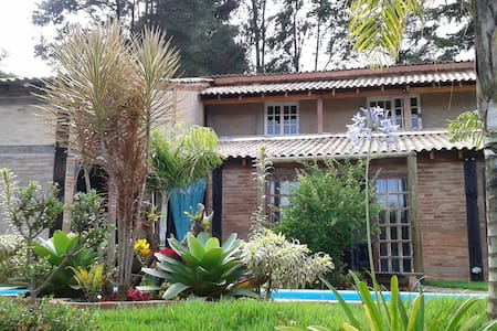 Vila das Orquídeas - quarto - Guararema - Casa de campo