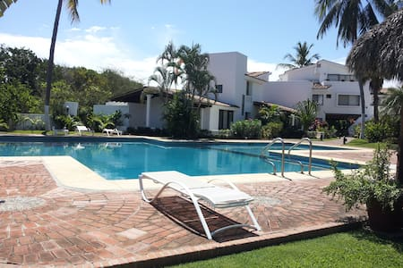 A home so gorgeous you won't want to leave! Beautiful backyard with pool, bbq area, palapa, and access to the river for kayaking adventures. Located in a safe gated community just a 15 minute drive from Puerto Vallarta. Great for families or a vacati