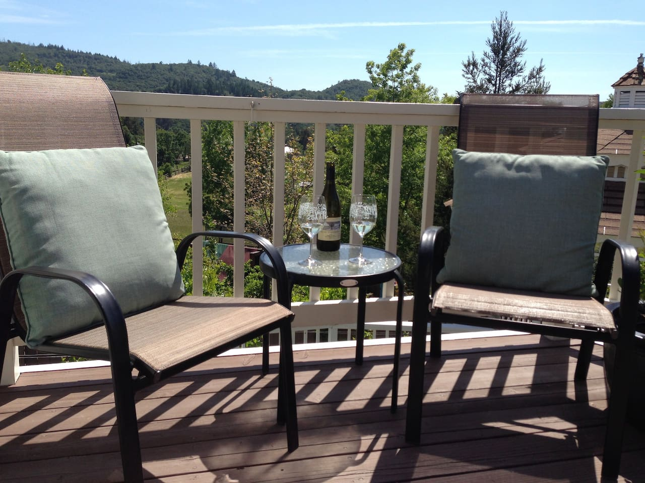 Enjoy a glass of wine on the sunny deck