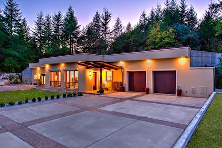 Modern home nestled amongst nature.
