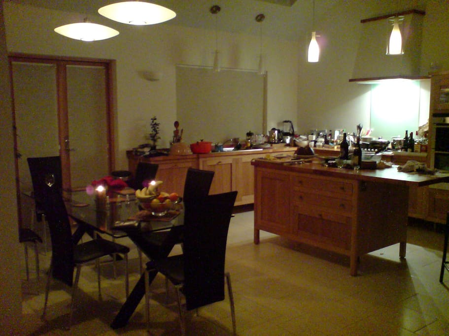 Kitchen / dining at night.. (glass table now replaced with wooden table& benches..)