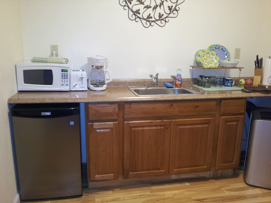 Kitchenette, re-fridge, coffee maker, hot water boiler, toaster, and microwave
