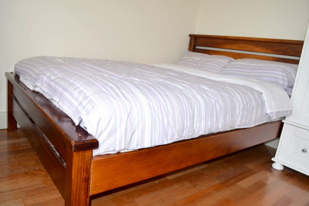 Solid teak bed with double pillow high quality matress designed for a perfect sleep