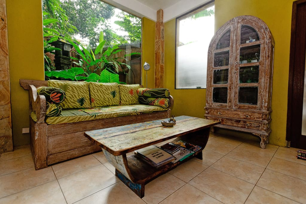 Our living room with boat wood coffee table and bali bench...