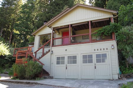 A quaint 1940's cottage, nestled hillside amongst tall redwood trees, on two thirds of an acre, only a mile from downtown Guerneville.