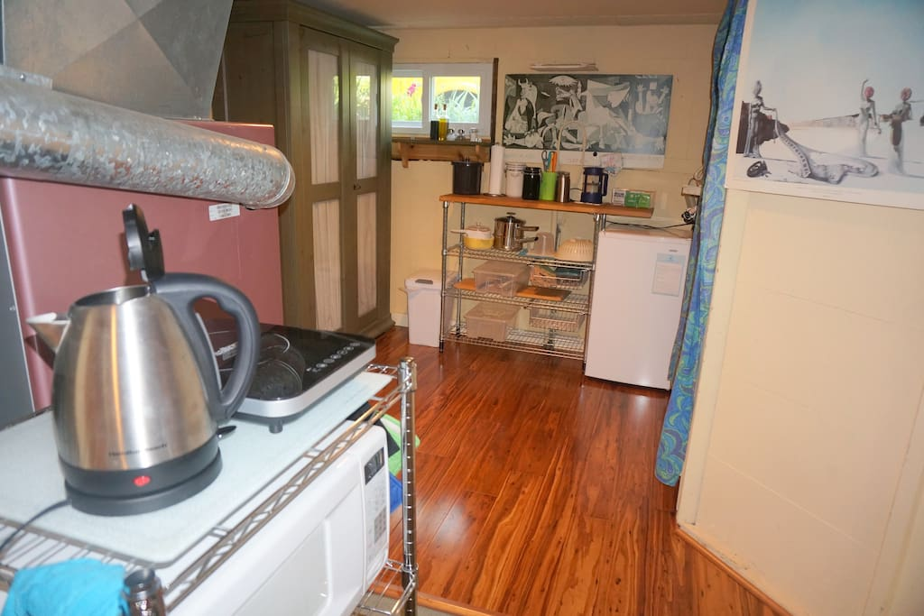 An electric kettle, an induction cooktop, a  microwave &  cookware are available for basic meals. Note - This isn't a full kitchen: we offer an induction cooktop instead of a stove/oven; no kitchen sink, but we wash your dishes daily.