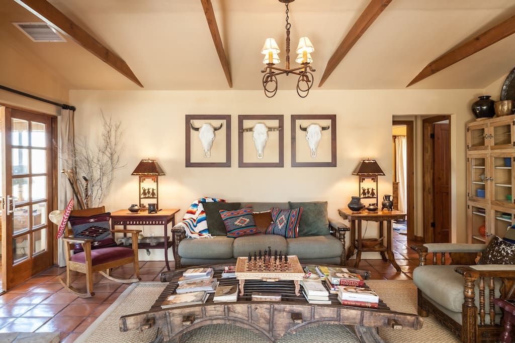 The living room is the core of the house, featuring wood stove, TV, chess board, comfortable ranch-style seating and loads of antiques.