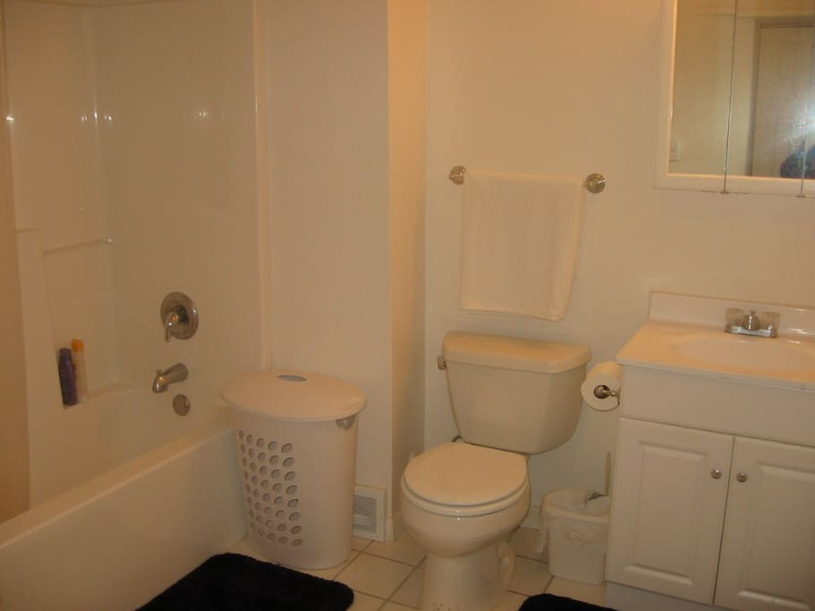 Spacious bath with tub and storage space.