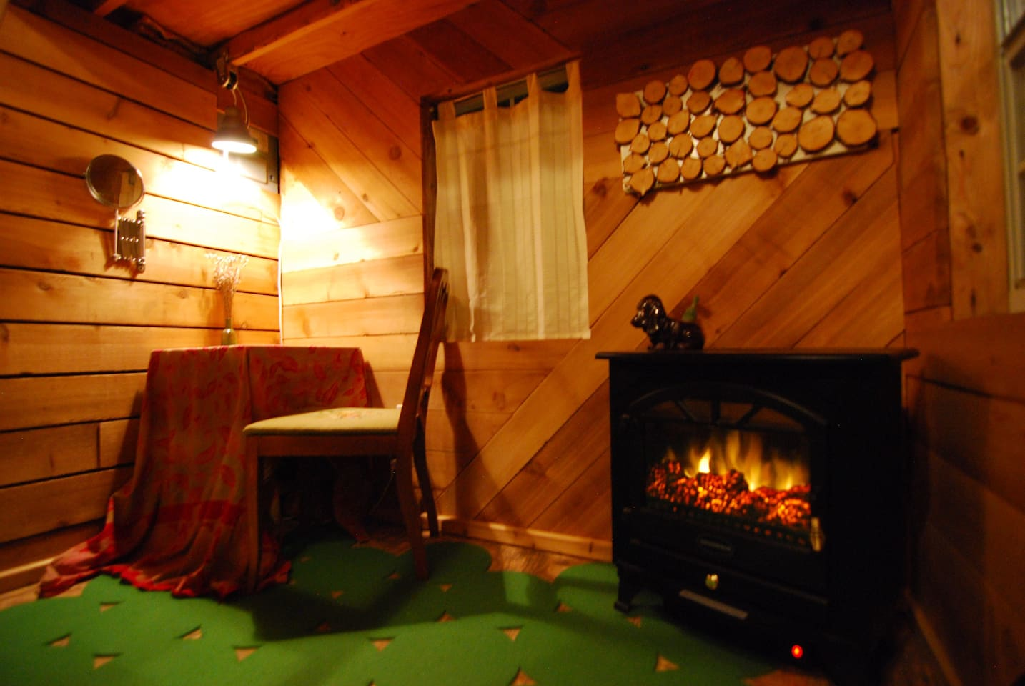 cozy fire heater and multipurpose table and chair with light and mirror.