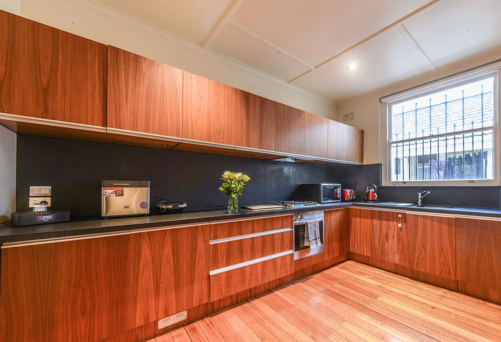 Huge kitchen with all the mid cons, including a espresso coffee machine &  seater dining table.