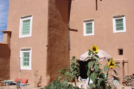 Maison à énergie solaire en pisé - Erdhaus