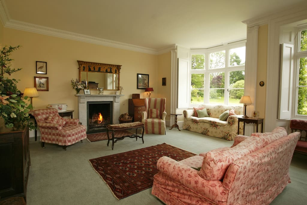 Large bright sitting room with open fire for your use