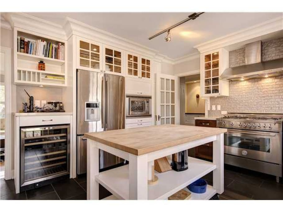 Custom designed and built kitchen with Italian six burner gas stove/oven, French door refrigerator with ice-maker, wine cooler, in-floor heating, can be closed off with French doors for quiet, and a gourmet's dream for utensils.