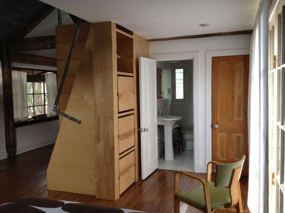 Full bathroom with shower. Drawers under stairs hold extra bedding for fold out couch in loft area.  Two closet spaces to make yourself at home.  Ironing board and iron provided.