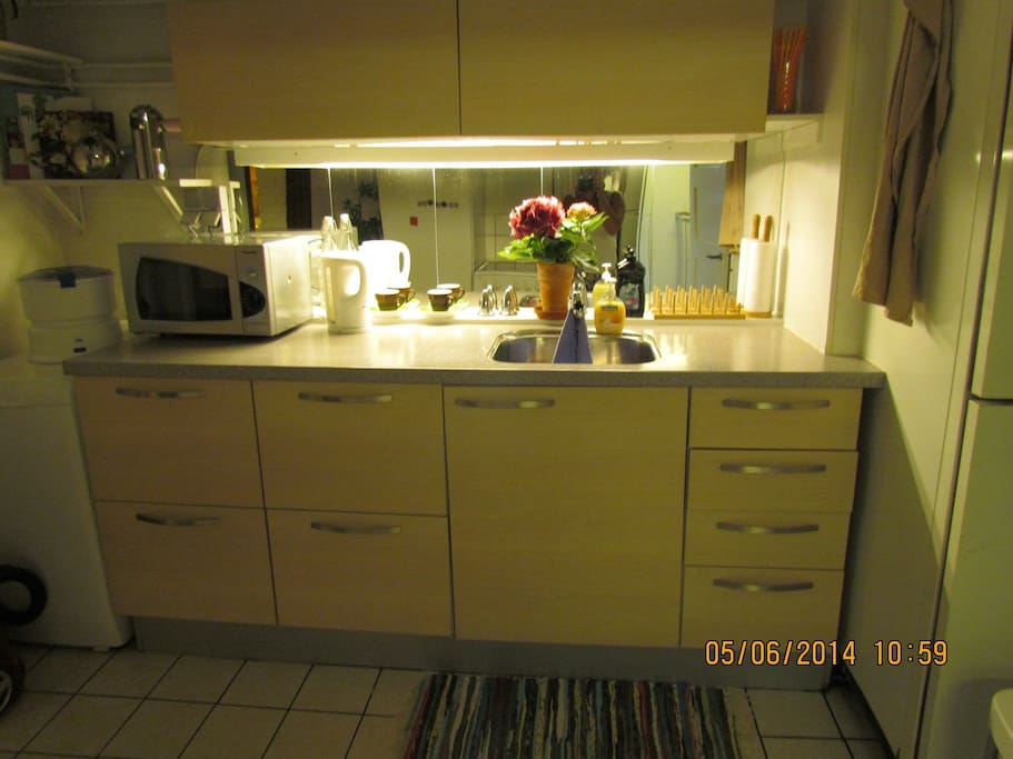 Fully equipped new kitchen with stove, fridge and freezer.