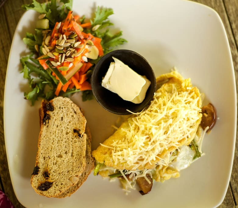 Free Breakfast option: Mandala Omelette stuffed with veggies and cheese, with homemade bread and fresh side salad.