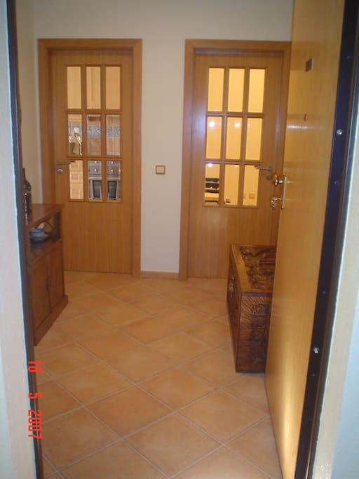 Entrance hall that gives to kitchen and dining/iving room