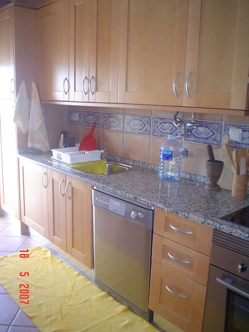 Fully equiped kitchen: table and 4 benches, dishwasher, vacuum cleaner, stove with ceramic plate, oven, refrigerator, microwave ans terrace