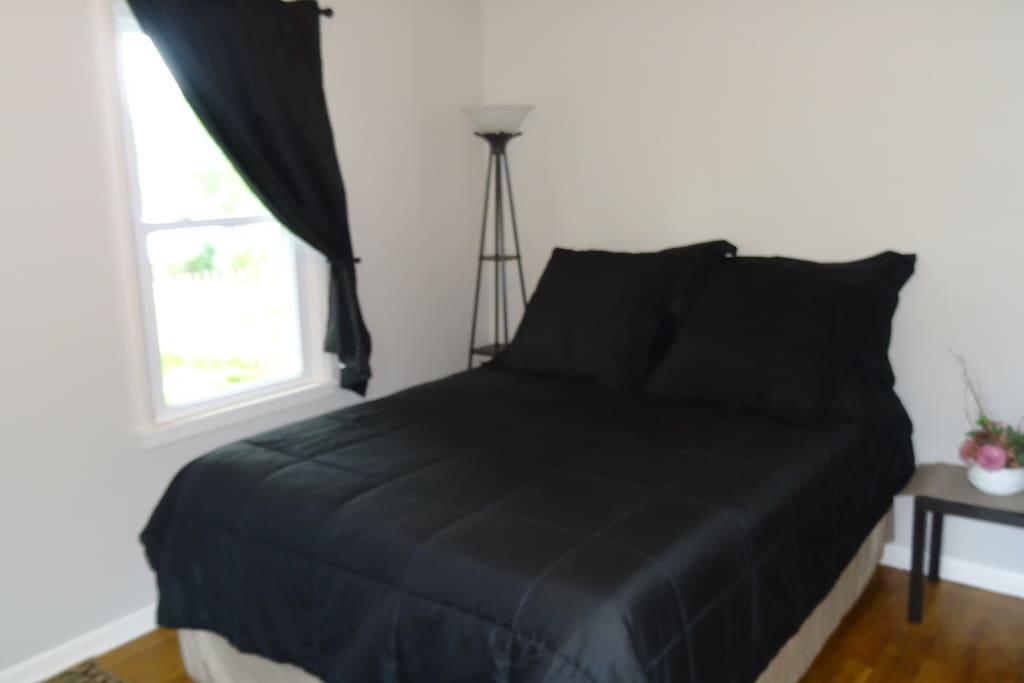 Bedroom #2:  Queen size bed with new mattresses and bed coverings summer of 2013.