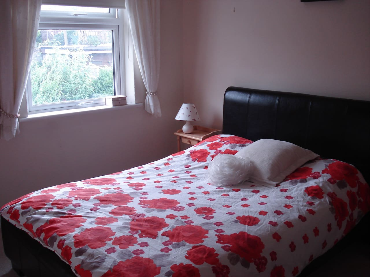 Quiet, sunny bedroom at the back of the house, with a black out blind to help you sleep!