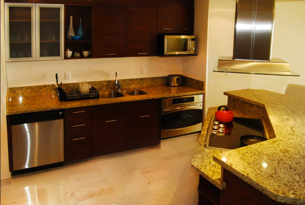 Electric stove, oven, dishwasher, microwave, coffee maker, fridge. All the appliances to prepare whatever you want. There are nearby grocery stores.