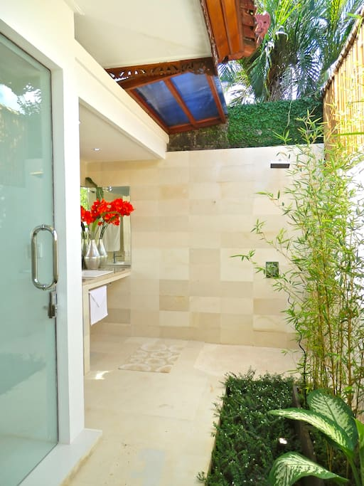 BATH 1 Enjoy the absolute feeling of freedom as the morning sun drenches your body in the out door bathroom. Classy, private and Clean..now with a separate out door relaxation, sun baking area.