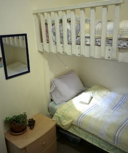 Co-ed dorm bed in small bunkroom (bed 2 of 3) - Cambria - Bed & Breakfast