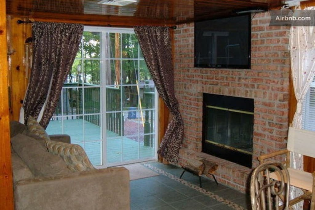 Living Room, out to deck and lake view in the distance