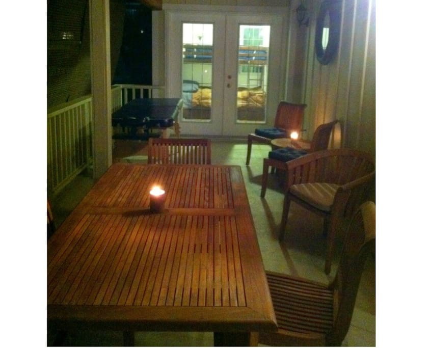 Deck at night with new teak table and massage table included