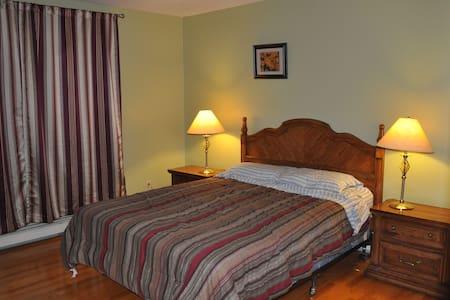 Queen Bedroom on Main Floor - Hus