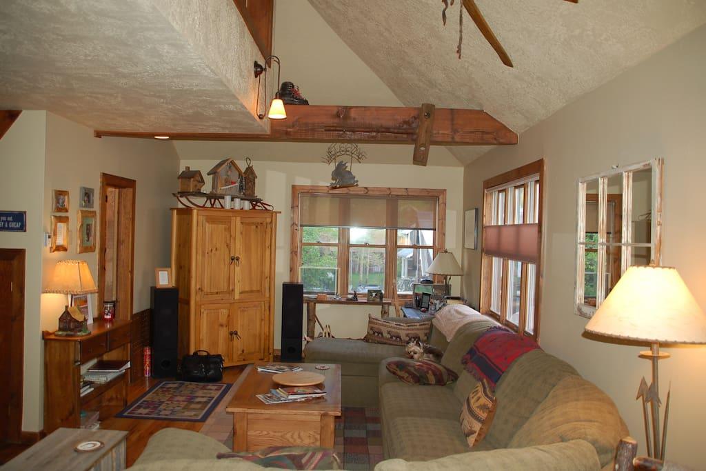Living room. Open floor plan with vaulted ceiling.
