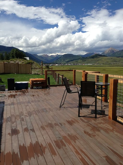 Huge deck with grill and new furniture.