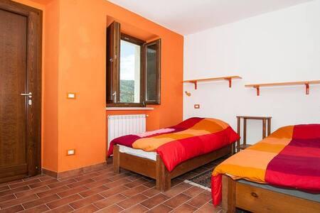 B & B Tra Terra e Cielo Camera arancione - Apartamento