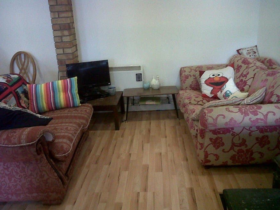 Cosy seating area with TV/DVD player.